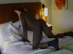 Cuckold sits on the couch in the hotel room as his wife gets railed by a black guy