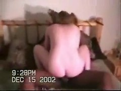 Wife fucked by a fat black cock in a cuckold home video as hubby watches
