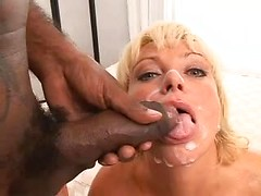 Black dick leaves a nice layer of thick cum on the face of a pretty white girl