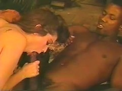 Her lovely white mouth sensually sucks on his big black dick to make it cum